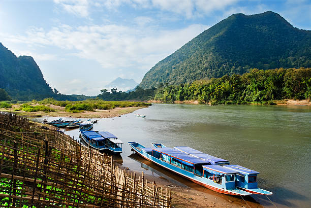 muang ngoi boats - mekong river stock pictures, royalty-free photos & images