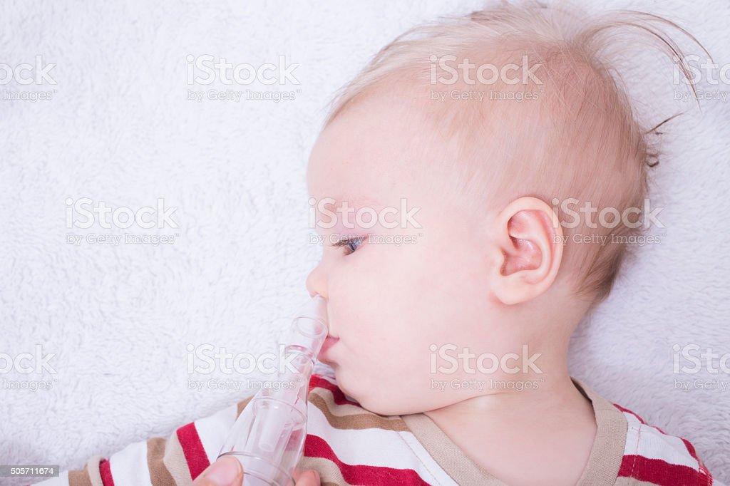 Mucus suction stock photo