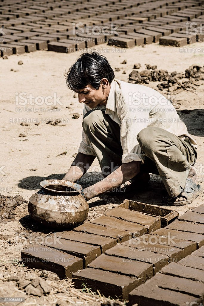 Mud Brick Manufacturing in India stock photo