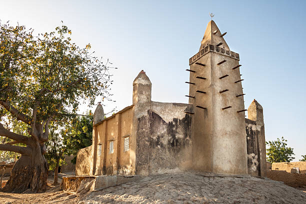 Mud brick mosque in a small village, Mali, Africa. stock photo