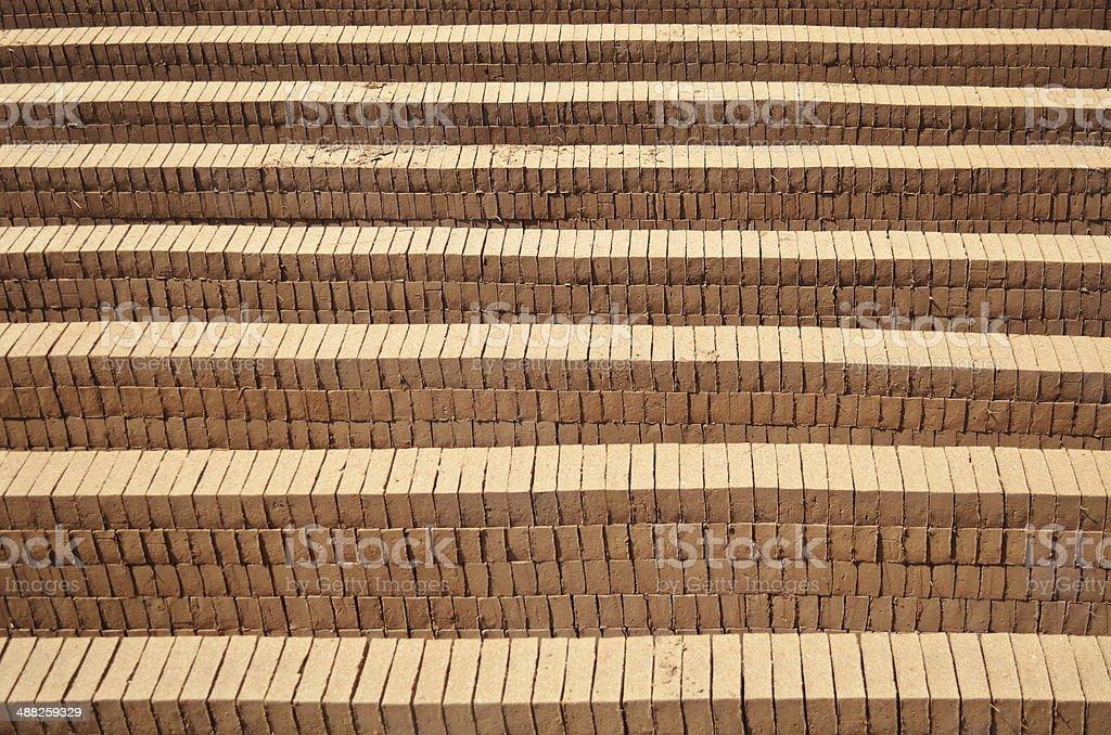 Mud bricks stacked together stock photo