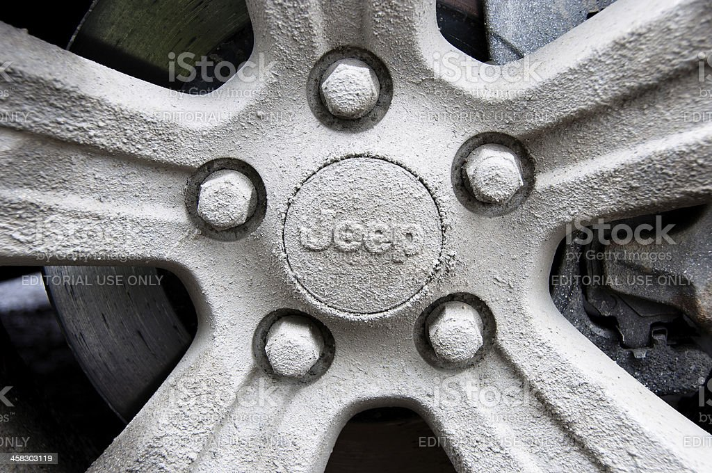 Mud covered Jeep rim stock photo