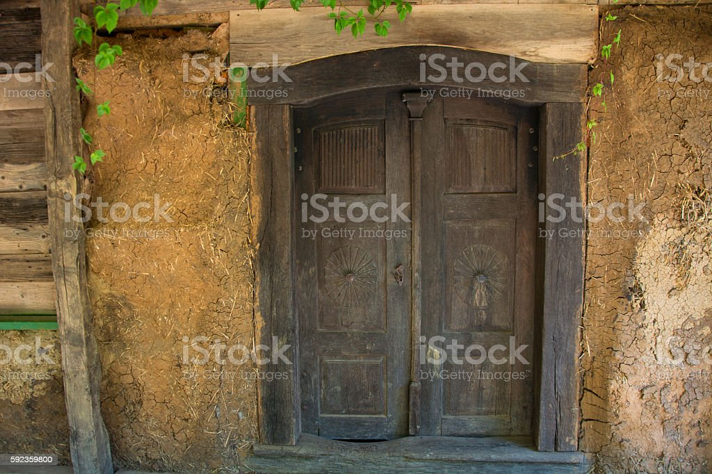 Nice old mud house with rustic wooden front door