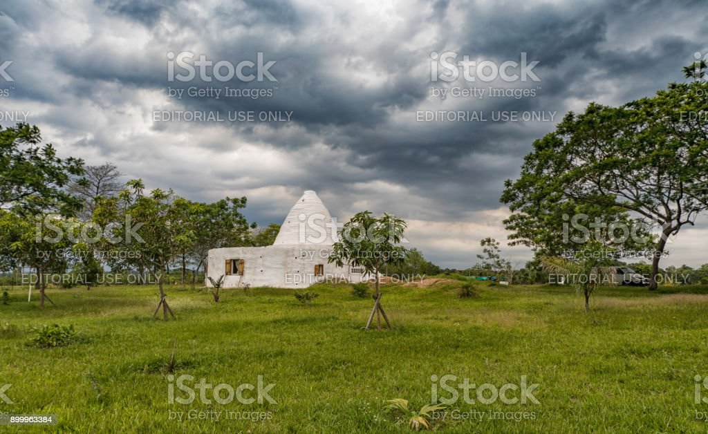 A mud house in round design, as it is more and more to see in Paraguay. stock photo