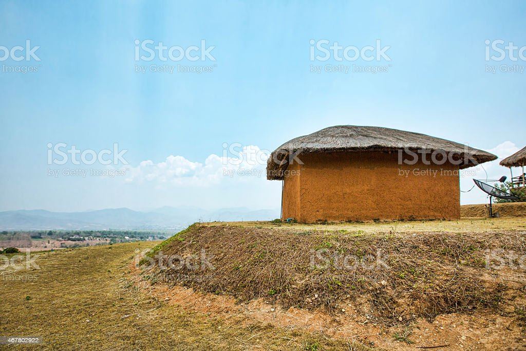 Mud house with satellite in the mountains, traditional small village stock photo