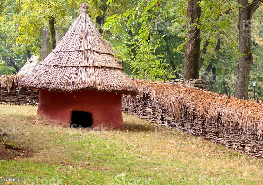 Mud hut with straw roof stock photo