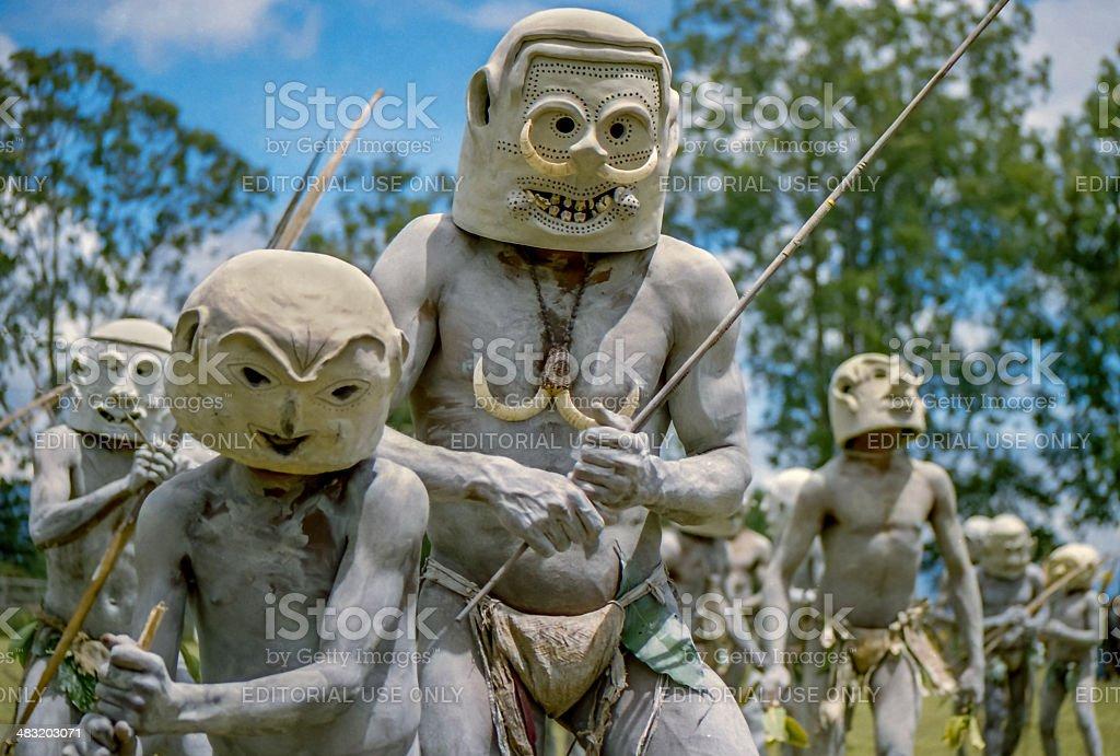 mud men stock photo