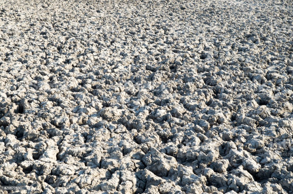 Mud of lake bed drying up due to drought stock photo