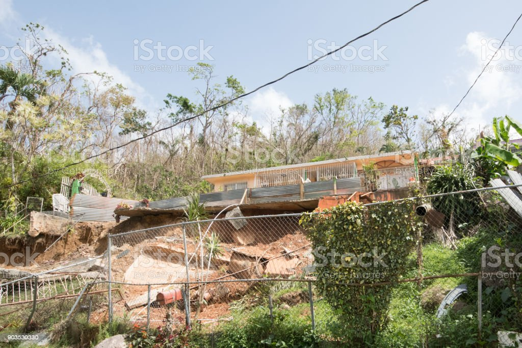 Mud slide on Puerto Rico road after Hurricane Maria stock photo