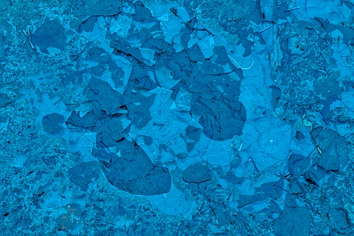 istock Mud texture or wet Navy peony colored soil as natural organic clay and geological sediment mixture 962979824