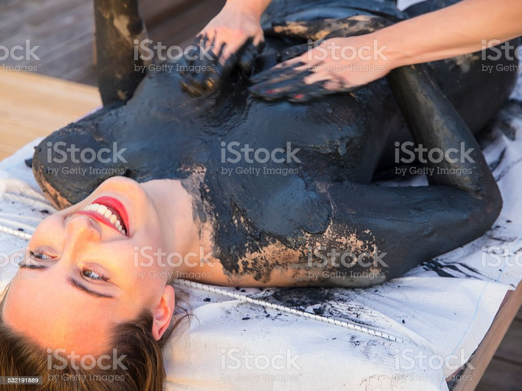 Mud Therapy and  Massage stock photo