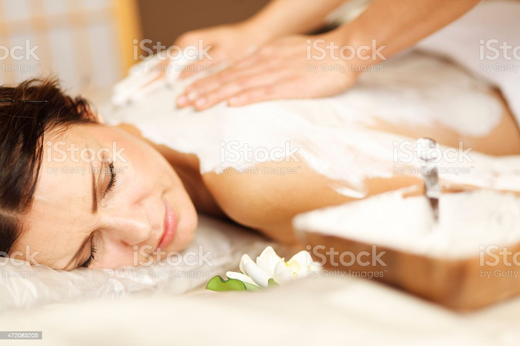 Mud treatment - body mask stock photo