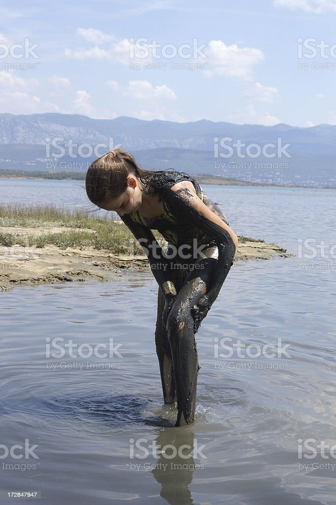 Mud treatment in the sea royalty-free stock photo