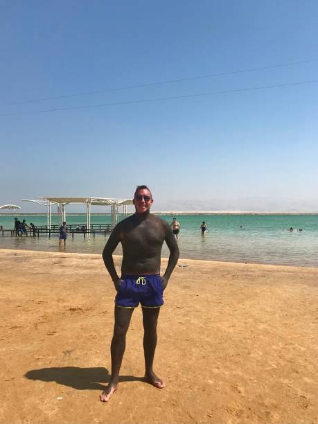 Mudding at the Dead Sea. stock photo
