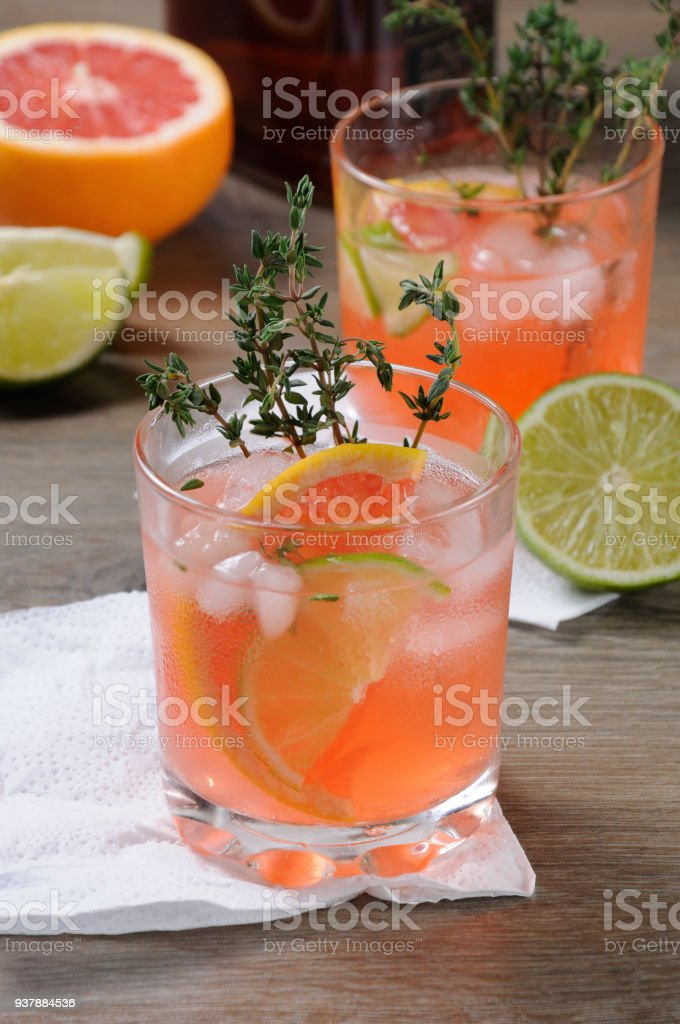 Muddled lime and thyme, combined with fresh grapefruit juice and delicious bourbon, it's the perfect  cocktail   to serve at any occasion stock photo