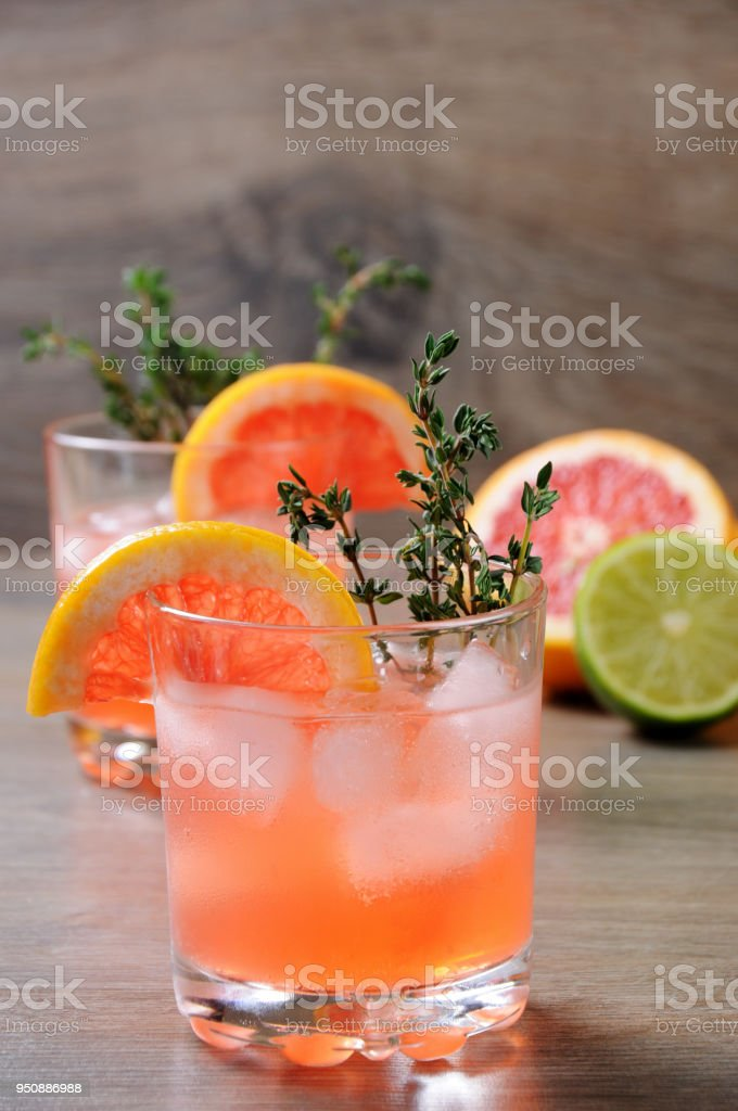 Muddled lime and thyme, combined with fresh grapefruit juice and delicious bourbon,  This cocktail is refreshing, full of flavour and totally gorgeous   the perfect cocktail to serve at any occasion stock photo