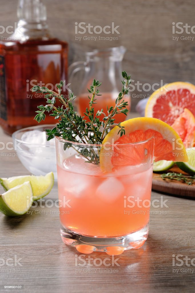 Muddled lime and thyme, combined with fresh grapefruit juice and delicious bourbon  . This cocktail is refreshing, full of flavour and totally gorgeous – it's the perfect cocktail to serve at any occasion stock photo