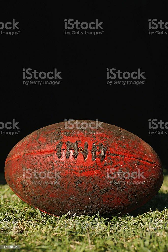 Muddy AFL Ball royalty-free stock photo