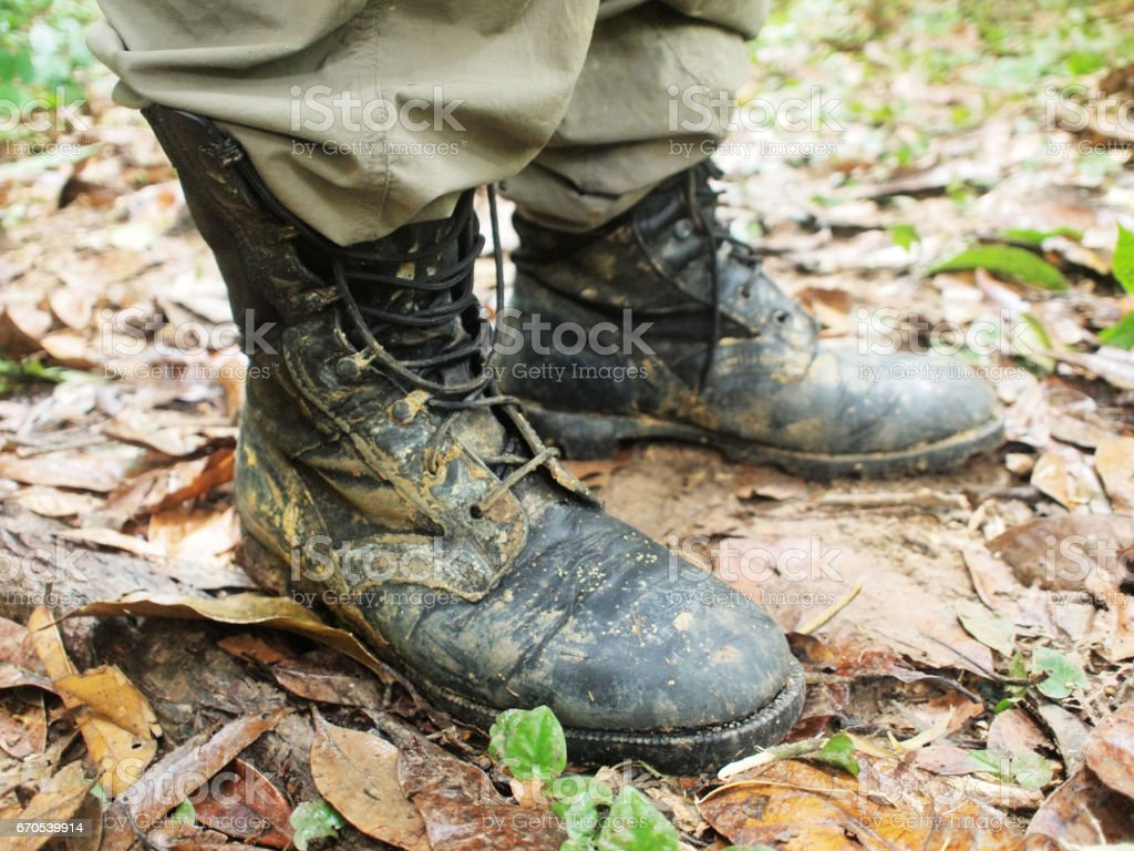 muddy boots in the jungle stock photo