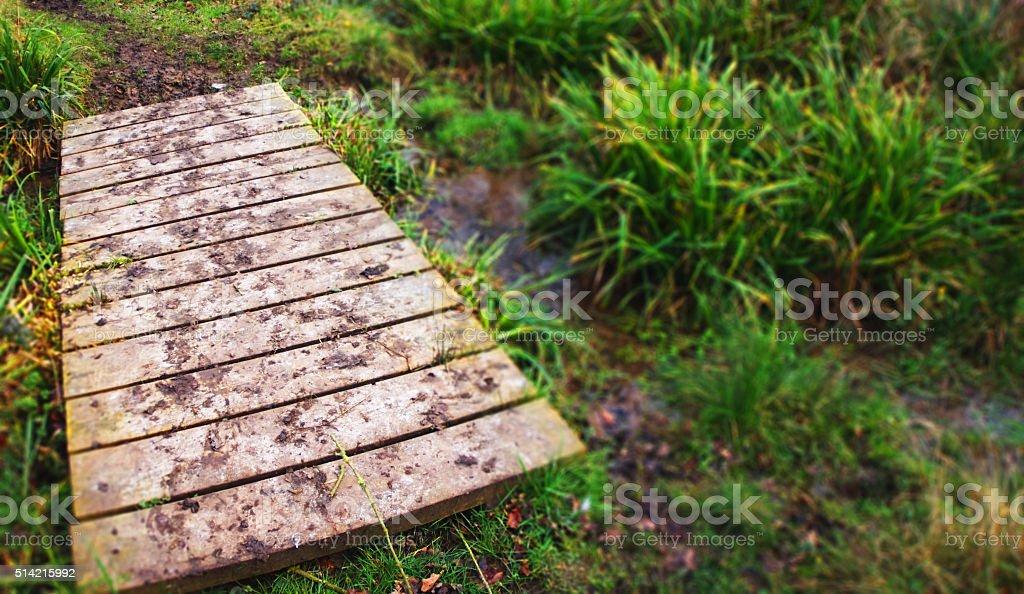 Muddy bridge stock photo