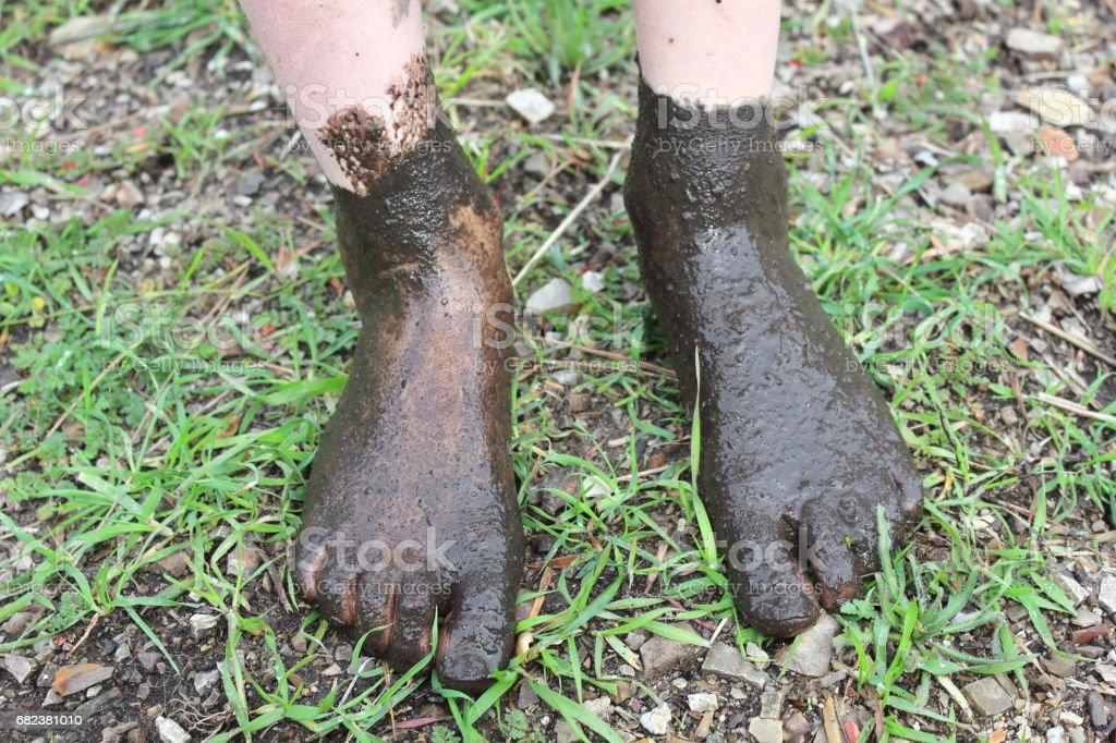 Muddy Feet stock photo