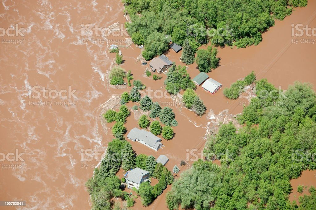 Muddy Floodwater Surrounds Homes stock photo