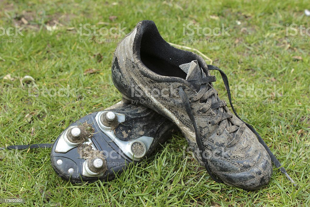 Muddy football boots stock photo
