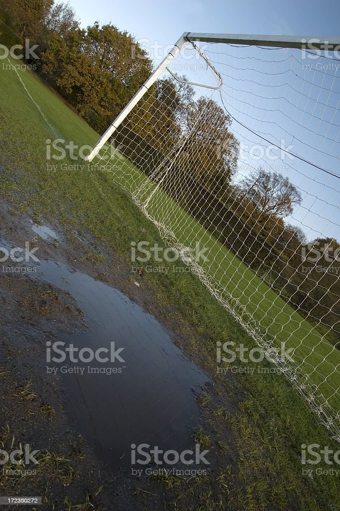 Muddy football pitch royalty-free stock photo