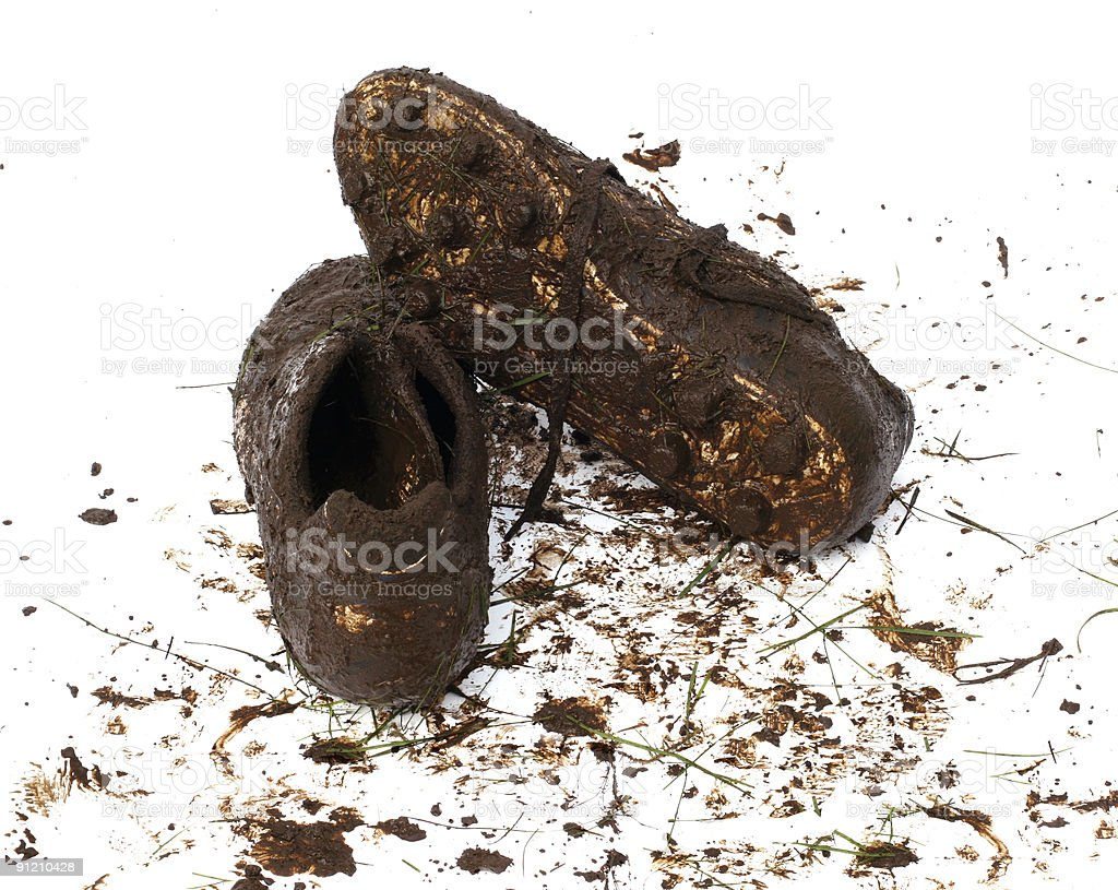 Muddy football shoes after the game stock photo
