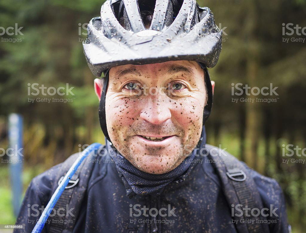 Muddy Mountain Biker stock photo