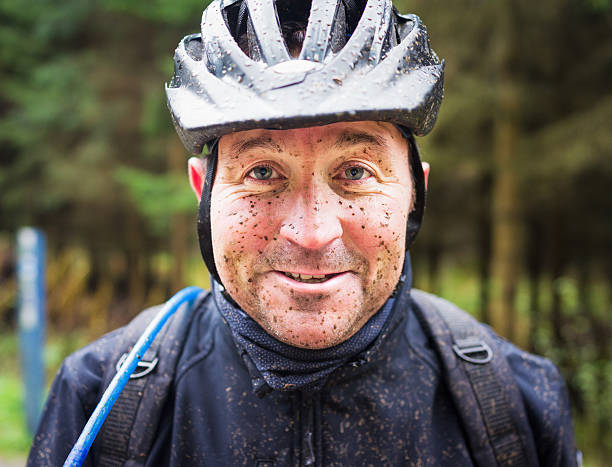 muddy mountain biker - mountain biking stock photos and pictures