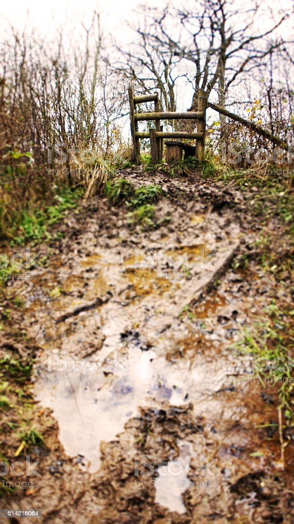 Muddy path to a Stile stock photo