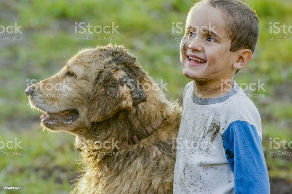 Muddy Playtime stock photo