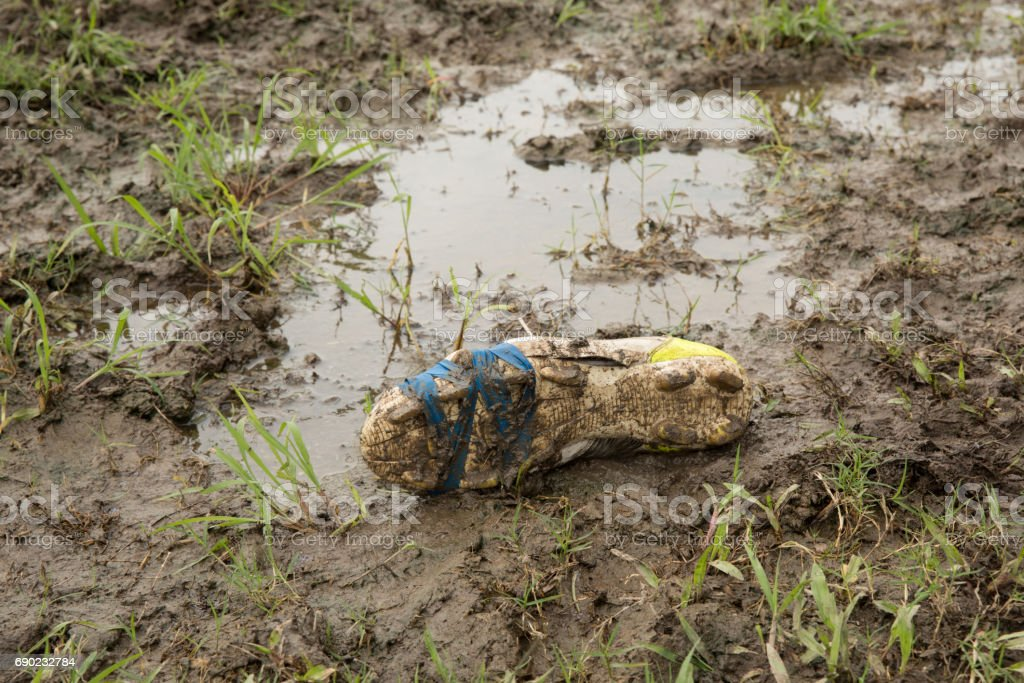 Muddy Rugby Boot stock photo