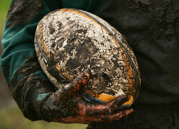muddy rugby - rugby ball stock photos and pictures