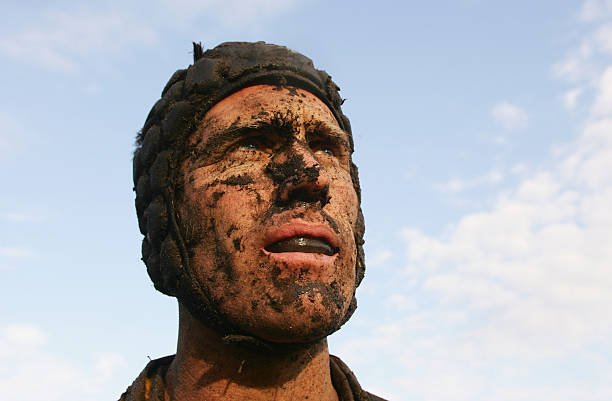 Muddy Rugby Player stock photo