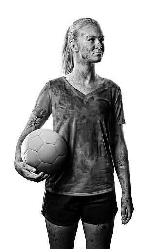 Muddy Teenage Girl with Soccer Ball on White