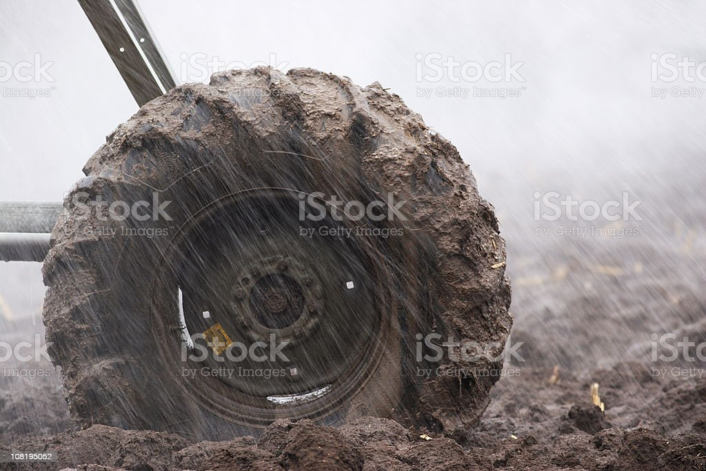 Muddy Tire Agriculture Irrigation Sprinkler stock photo
