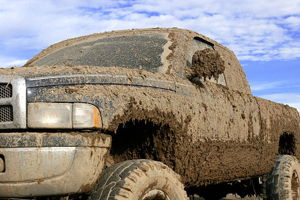 muddy truck - mud stock photos and pictures