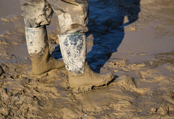 Muddy work boots stock photo
