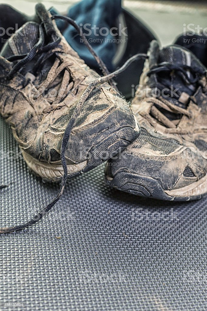 Muddy Worn Out Athletic Running Sneaker Shoes stock photo