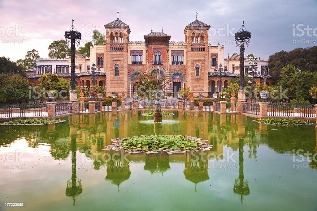Mudejar Pavilion and pond at sunset. Sevilla royalty-free stock photo