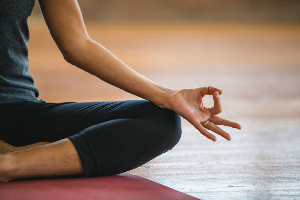 Mudra and lotus pose exercises. Woman practicing yoga meditation Mudra and lotus pose exercises. Woman practicing yoga meditation yogi stock pictures, royalty-free photos & images