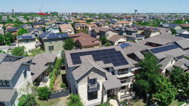 Mueller Suburb Solar Panel Rooftops and Modern Austin Living Aerial drone view of suburb neighborhood in East Austin community houses and homes - Mueller Suburb Solar Panel Rooftops and Modern Austin Living solar panels photos stock pictures, royalty-free photos & images