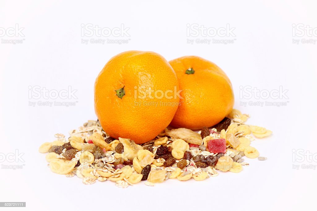 Muesli and tangerines stock photo