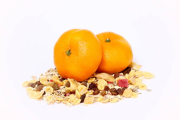 Muesli and tangerines stock photo