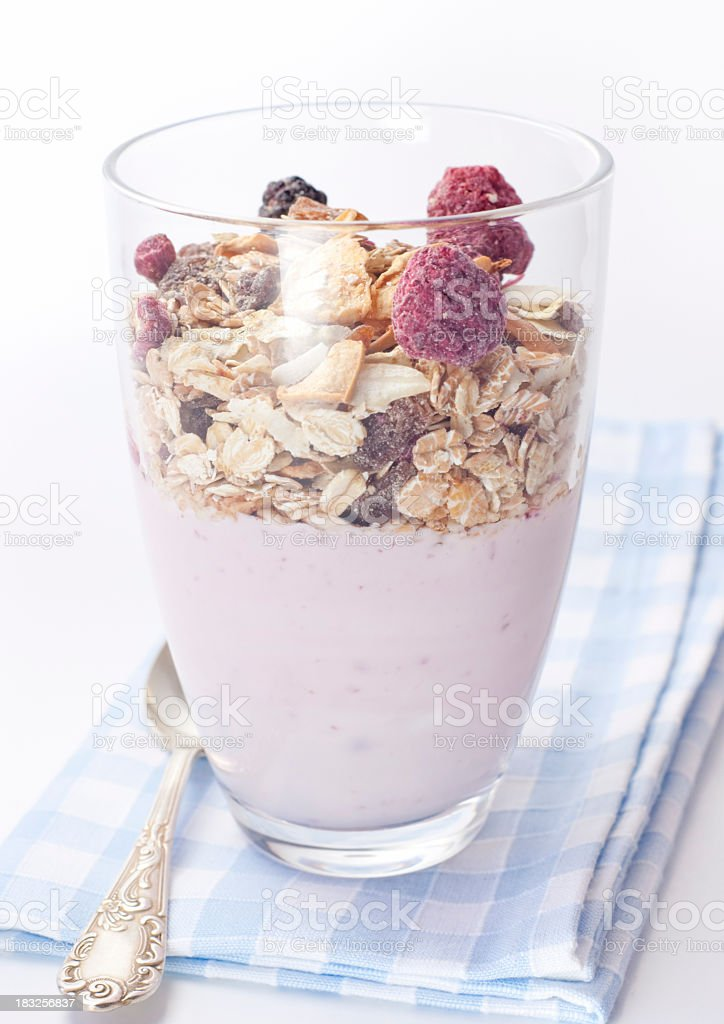 Muesli and yoghurt in a drinking glass royalty-free stock photo