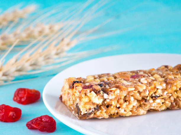 muesli bar on blue background stock photo