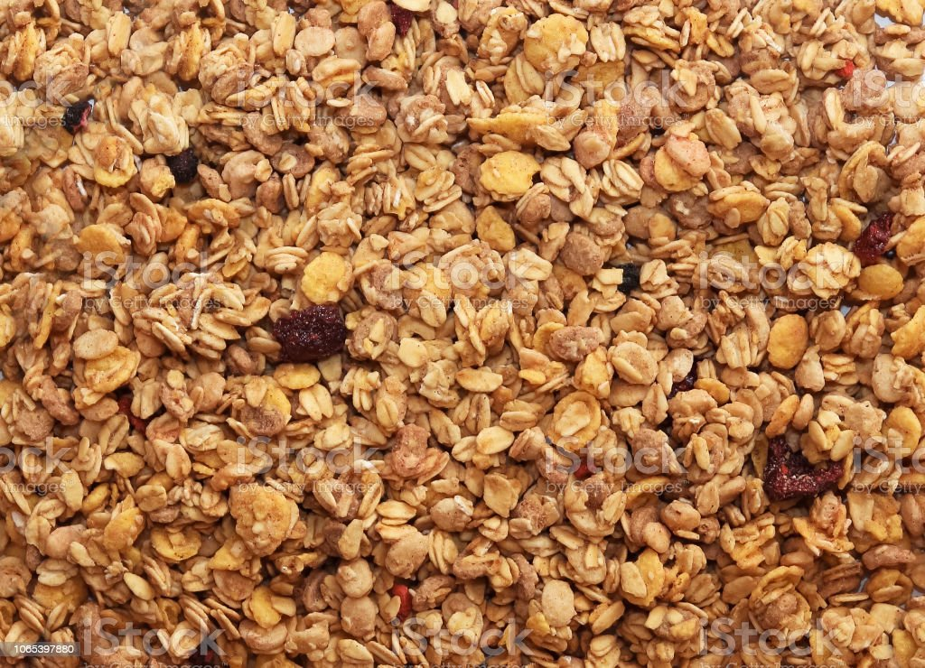 Muesli breakfast background. Organic crunchy homemade granola cereal with oats and berries. royalty-