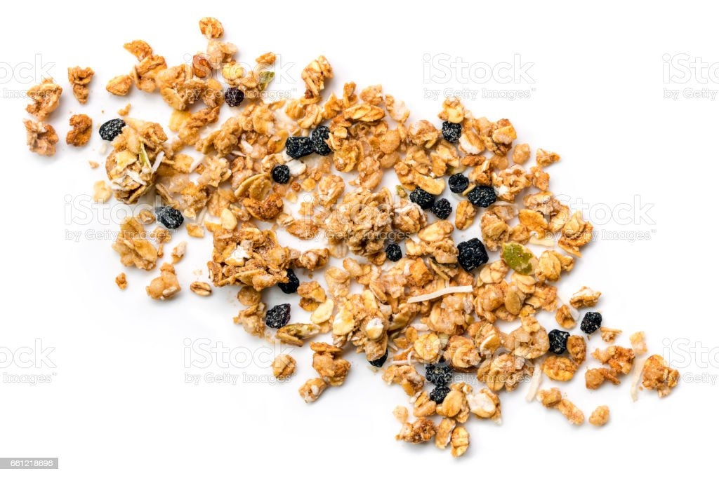 Muesli or Granola Scattered on White Top view stock photo